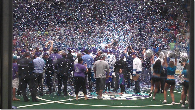 Players, cheerleaders, families, and confetti